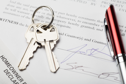house keys with signed settlement document and pen; signatures are fictitious